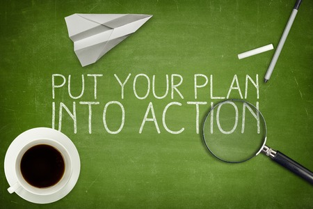 Put your plan into action concept on blackboard with coffee cup Stock Photo