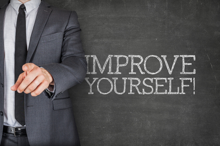 yourself: Improve yourself on blackboard with businessman finger pointing