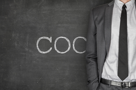 coo: COC on blackboard with businessman in a suit on side