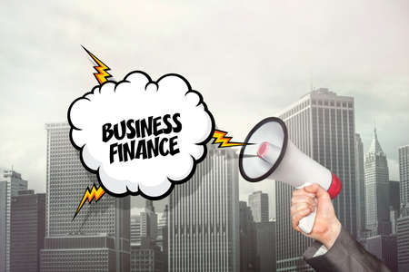 sponsorship: Business finance on speech bubble and businessman hand holding megaphone on cityscape background