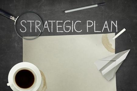 strategic plan: Strategic plan concept on blackboard with pen