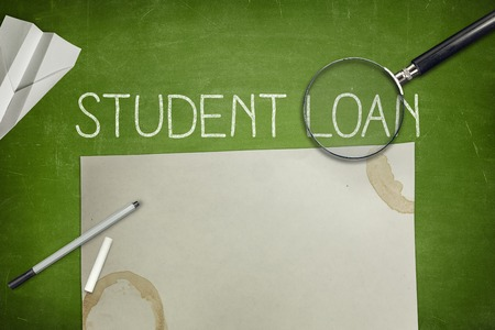 dues: Student loan concept on blackboard with pen Stock Photo