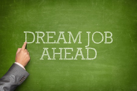 beforehand: Dream job ahead text on blackboard with businessman hand pointing