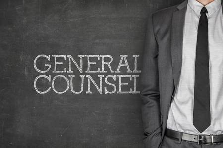 rightful: General counsel on blackboard with businessman in a suit on side