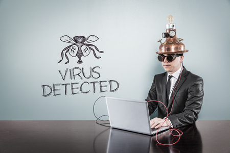 computer virus protection: Virus detected concept with vintage businessman and laptop at office Stock Photo