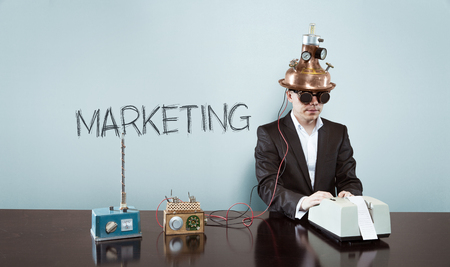 marketing concept: Marketing concept with vintage businessman and calculator at office