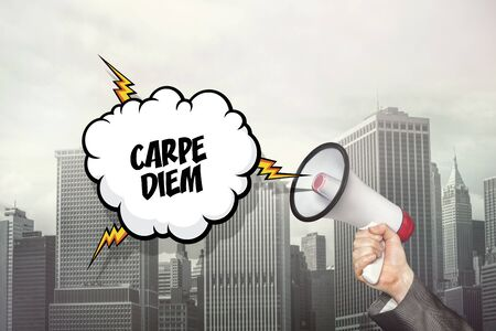 carpe diem: Carpe diem text on speech bubble and businessman hand holding megaphone on cityscape background