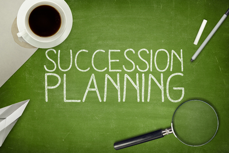 Succession planning concept on blackboard with pen Imagens
