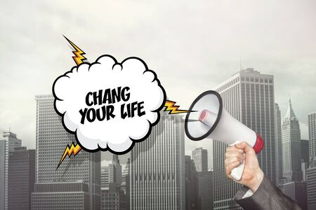 life change: Change your life text on speech bubble and businessman hand holding megaphone on cityscape background Stock Photo