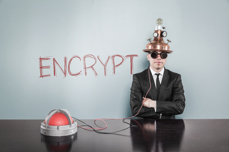encrypt: Encrypt concept with vintage businessman and calculator at office