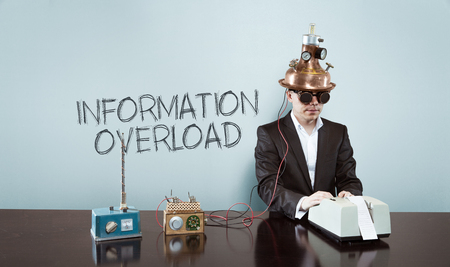 Information overload concept with vintage businessman and calculator at office