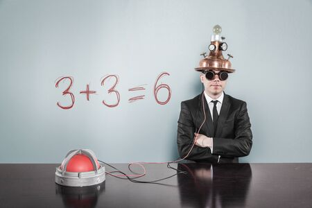 Mathematics concept with vintage businessman and calculator at office