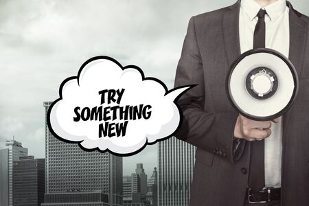 alter: Try something new text on speech bubble with businessman and megaphone on city background Stock Photo