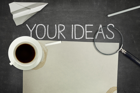 inventiveness: Your ideas concept on blackboard with pen Stock Photo