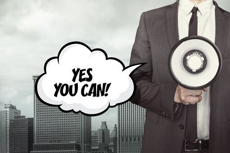 can yes you can: Yes you can text on speech bubble with businessman and megaphone on city background