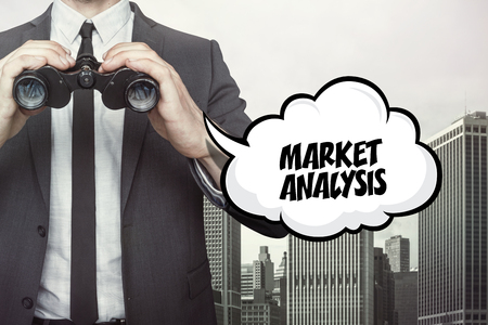 estimating: Market analytics text on speech bubble with businessman holding binoculars on city background Stock Photo