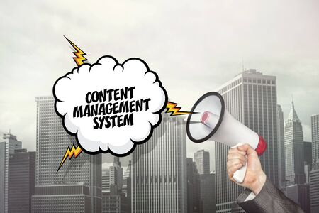 contented: Content management system text on speech bubble and businessman hand holding megaphone on cityscape background