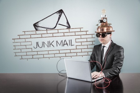 junk mail: Junk mail procection concept with vintage businessman and laptop at office