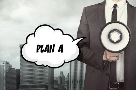stratagem: Text on speech bubble with businessman and megaphone on city background