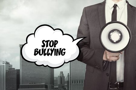 maltreatment: Text on speech bubble with businessman and megaphone on city background