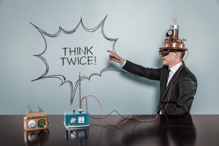 reconsider: Vintage businessman concept pointing on the wall wearing futuristic helmet at office