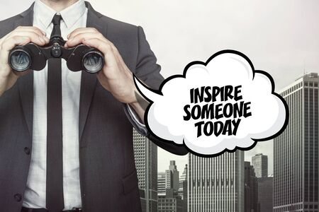 stimulate: Inspire someone today text on speech bubble with businessman holding binoculars on city background