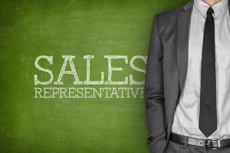 sales representative: Sales representative on blackboard with businessman on side