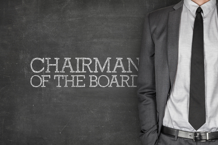supervisory: Chairman of the board on blackboard with businessman in a suit on side