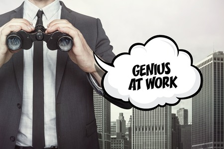 knowledgeable: Genius at work text on speech bubble with businessman holding binoculars on city background Stock Photo