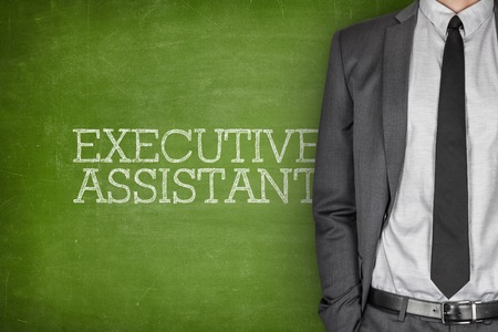 supervisory: Executive assistant on blackboard with businessman in a suit on side
