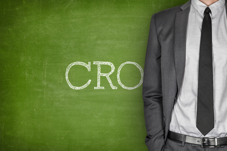 mitigating: CRO on blackboard with businessman in a suit on side Stock Photo