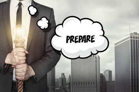 prepare: Prepare text on speech bubble with businessman holding lamp on city background