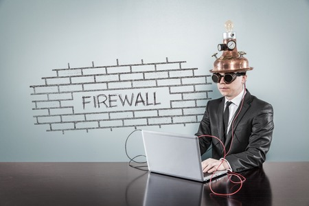Firewall concept with vintage businessman and laptop at office