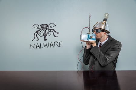malware: Malware text with vintage businessman kissing machine Stock Photo