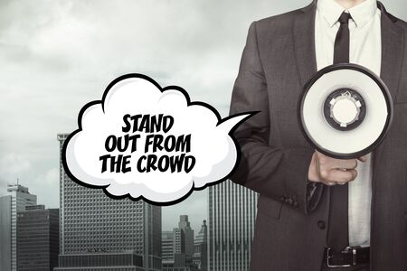 differed: Stand out from the crowd text on speech bubble with businessman holding megaphone