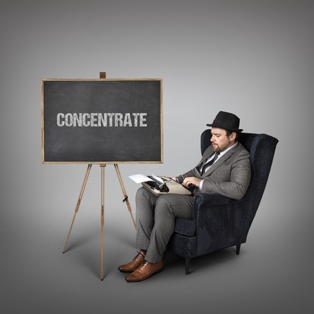 attentiveness: Concentrate text on  blackboard with businessman and key