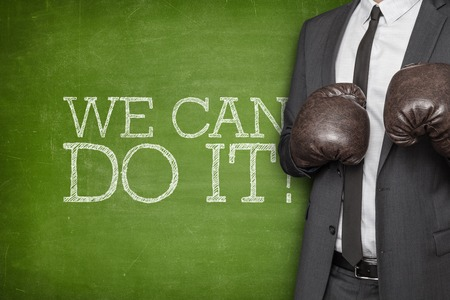 communication capability: on blackboard with businessman wearing boxing gloves