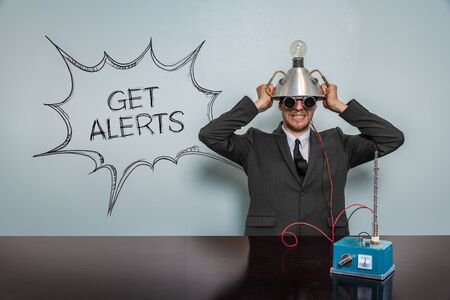 alerts: Get Alerts text with vintage businessman and machine at office
