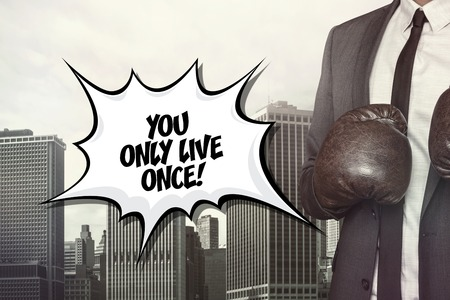 once: You only live once text on speech bubble with businessman wearing boxing gloves