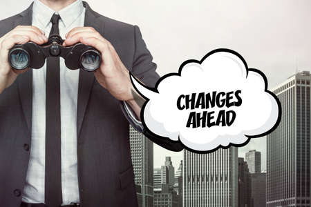 alterations: Changes ahead text on speech bubble with businessman holding binoculars
