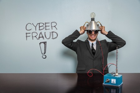 trickery: Cyber Fraud text with vintage businessman and machine at office