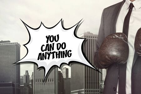 anything: You can do anything text on speech bubble with businessman wearing boxing gloves