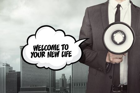 job opening: Welcome to your new life text on speech bubble with businessman and megaphone on city background