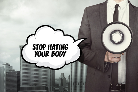 discontinue: Text on speech bubble with businessman and megaphone on city background