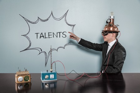 capacities: Talents concept with vintage businessman pointing hand