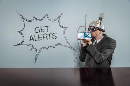 alerts: Get alerts text with vintage businessman kissing machine