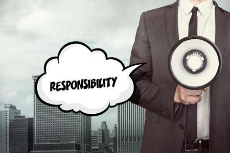 delegation: Responsibility text on speech bubble with businessman holding megaphone Stock Photo