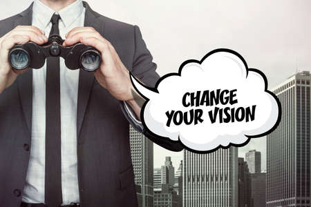 alteration: Change your vision text on  blackboard with businessman and key