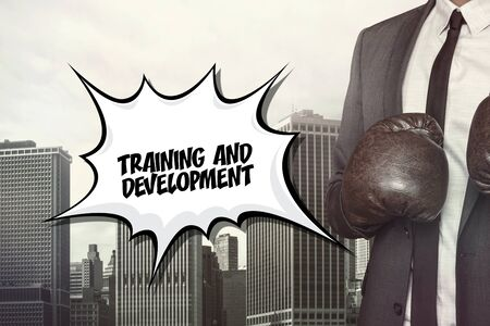 growth enhancement: Training and devevelopment text on speech bubble with businessman wearing boxing gloves