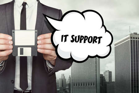 it support: IT Support text on speech bubble with businessman holding diskette